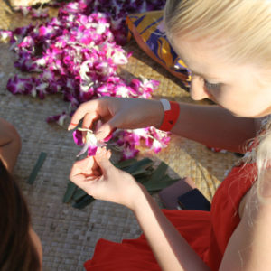 Lei-making is a fun hands-on luau activity