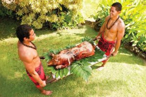 Kalua pig is one of the traditional foods found at every luau