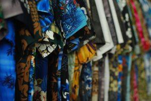 Brightly-colored aloha shirts are popular luau attire