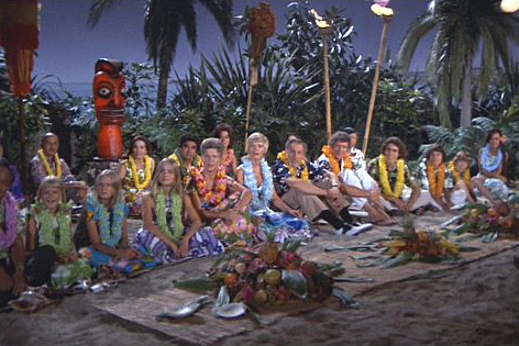 The Brady Bunch at a luau with their flower lei