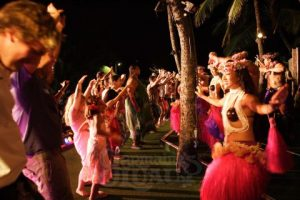 Nearly every luau offers hula lessons. Just go with it.