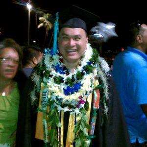 Happy grad with a few lei